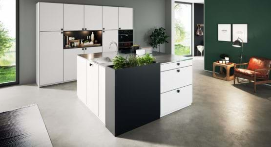 Rotpunkt white kitchen with black painted walls and open shelves