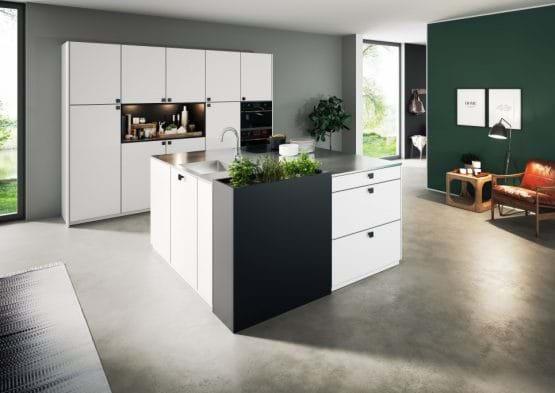 Rotpunkt Zerox kitchen with matt white cabinets and stainless steel worktops