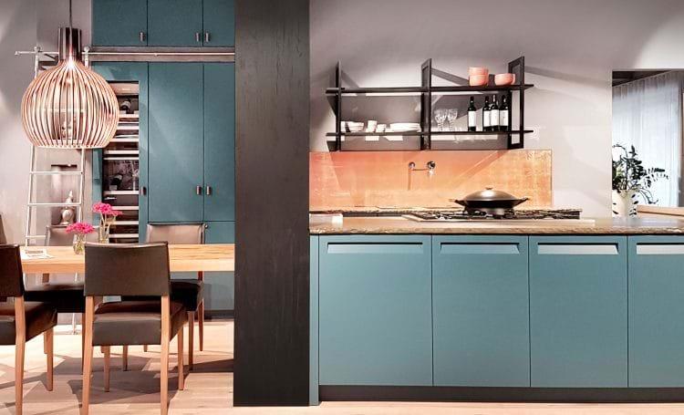 Blue Rotpunkt kitchen with glazed finish open shelves and copper splash back