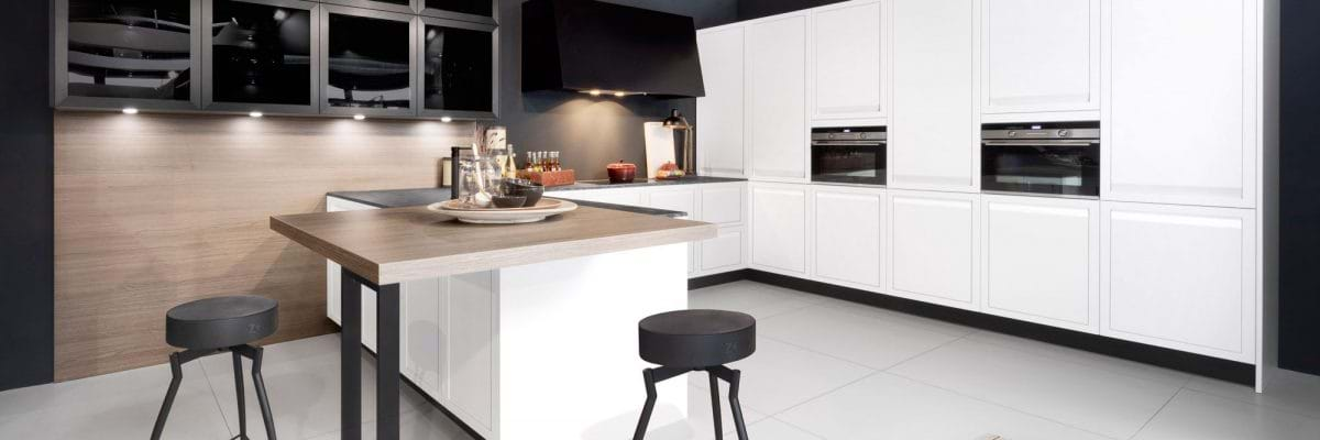 White kitchen from Rotpunkt kitchen collection with white worktop and two tone worktops