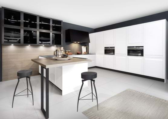 Rotpunkt Limit kitchen in white and black colour scheme with breakfast bar