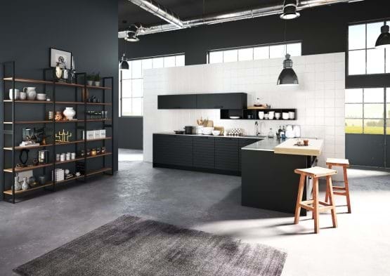 Rotpunkt Horizon kitchen with black painted cabinets and two tone wokrtops