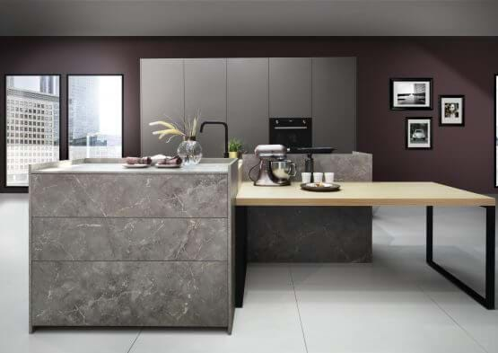 Grey kitchen from the Rotpunkt Umbra Marble kitchen collection. With handleless cabinet and matt black furniture s
