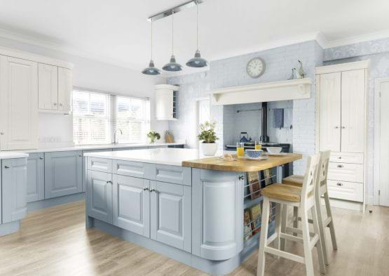Laura Ashley Bedale kitchen with blue painted cabinets, wooden work tops and island with built in bookshelf