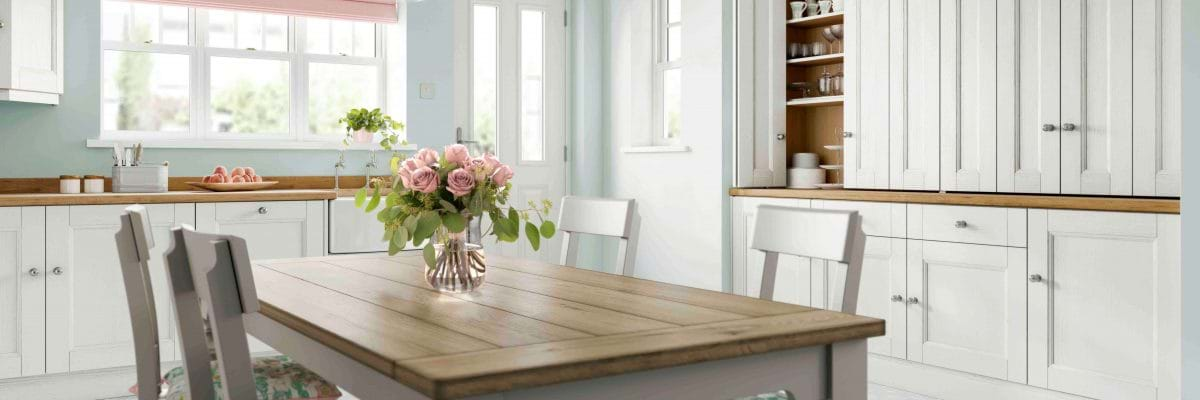Laura Ashley Bedale kitchen with blue painted wood cabinets and wood worktops