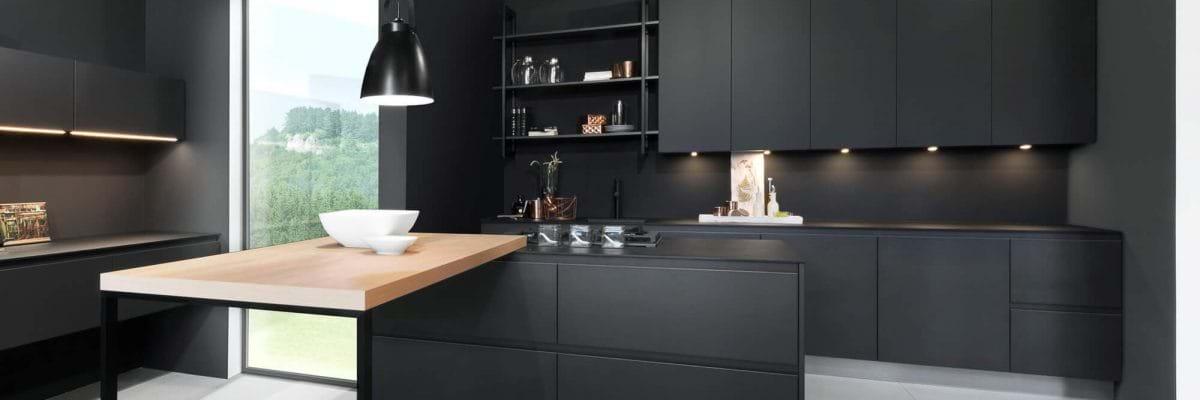 matt black kitchen with wooden breakfast bar