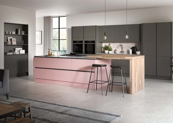 Sheraton Oblique kitchen with matt pink and grey cabinets and wood worktop breakfast bar