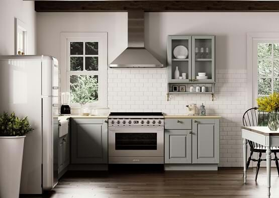 kitchen diner with pale blue kitchen cabinets, Smeg cooker and extractor fan