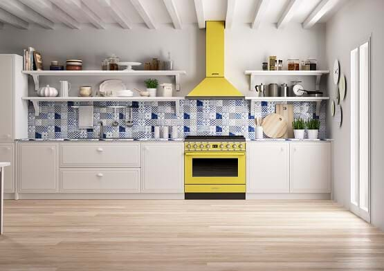 Kitchen with feature splash back and yellow Smeg cooker and hood