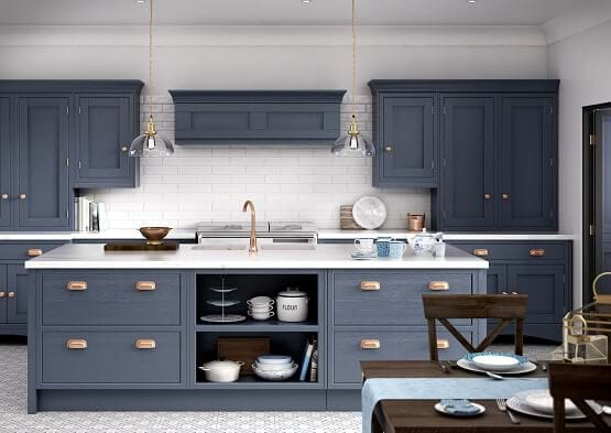 Laura Ashley Helmsley in navy blue colour scheme with marble worktop and copper hardware and handles
