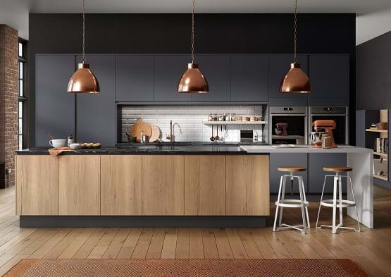 Sheraton Inset Cube kitchen in Dark Blue and New England Oak Woodgrain. Features handleless cabinets and copper accents