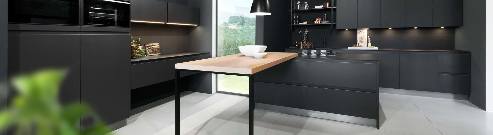 Rotpunkt kitchen in black colour scheme with matt finish and handleless cabinets