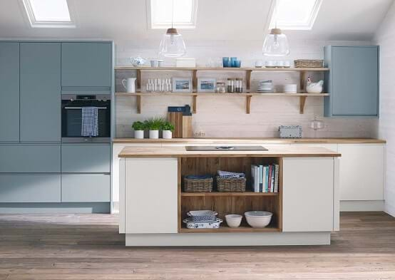 Laura Ashley Marlow kitchen with two tone cabinets in white and blue featuring island and handleless cabinets