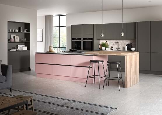 Sheraton Oblique kitchen with painted two tone cabinets in blush pink and graphite grey. Featuring island and handleless cabinets.