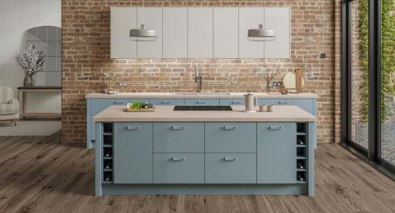 Laura Ashley Marlow kitchen with two tone cabinets in white and blue featuring built in wine racks and handleless cabinets
