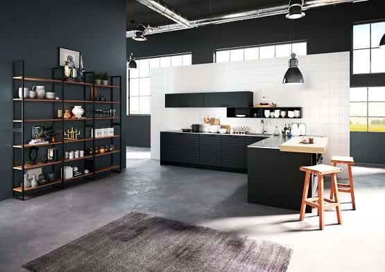 Rotpunkt kitchen in black colour scheme with wooden breakfast bar