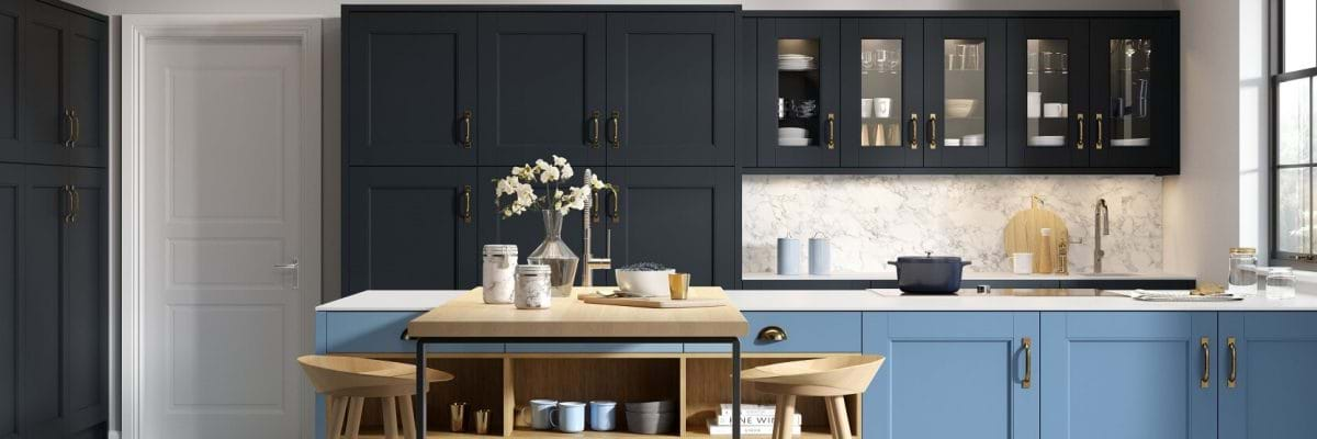 Chippendale Abbey kitchen in Indigo blue and Sky. Features two tone cabinets in blue and navy and wooden worktop breakfast bar