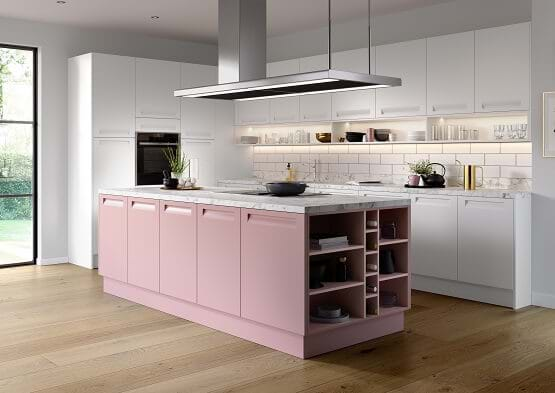 Chippendakle Affinity kitchen in blush pink and white features recess handles and two tone cabinets.