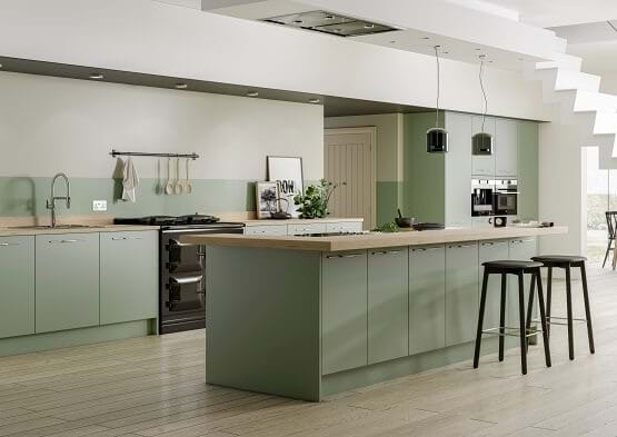 Casa kitchen in green colour scheme with matching splash back and wood worktops