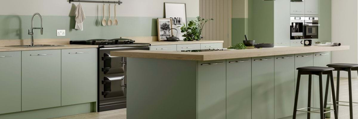 Sage Green kitchen with matching splash back and solid wood worktops