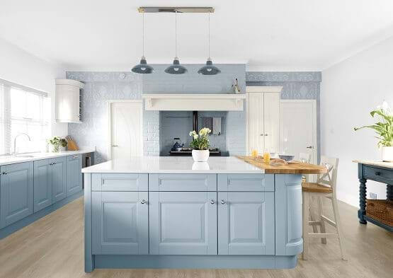 Laura Ashley Bedale kitchen in powder blue colour scheme. Painted kitchen with white marble worktop and wooden breakfast bar