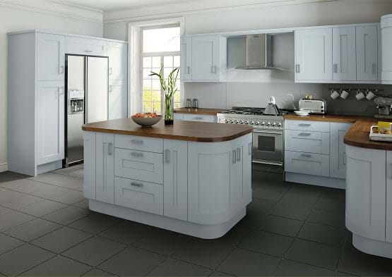 Verve painted shaker kitchen in pale blue finish with curved cabinets and natural woodgrain effect.