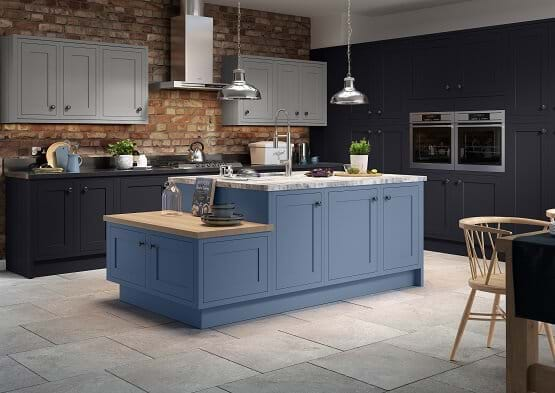 Sheraton Harmony kitchen with blue painted cabinets in three tones. Features floor to ceiling cupboards and island.