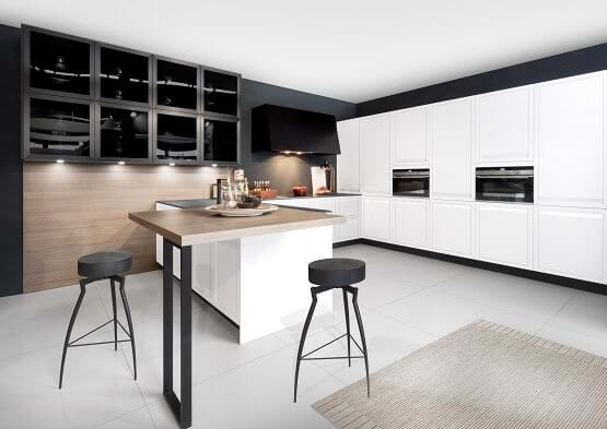 Rotpunkt kitchen and black and white colour scheme with white handleless cabinets and black open shelves.
