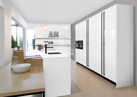 Rotpunkt You kitchen in white with black handles and tap for a black and white kitchen effect