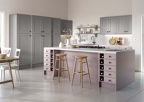 Chippendale Moda kitchen in pink and grey colour scheme. With integrated appliances and wine rack.
