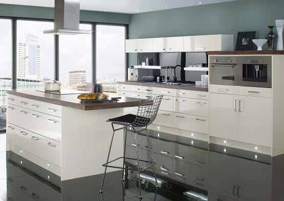 Chippendale Technica gloss kitchen in ivory with black floor tiles and walnut worktops