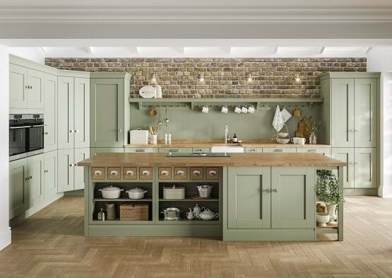 Laura Ashley Whitby kitchen in Atlantic Green colour scheme. Traditional style painted kitchen with wooden worktops and hardwear