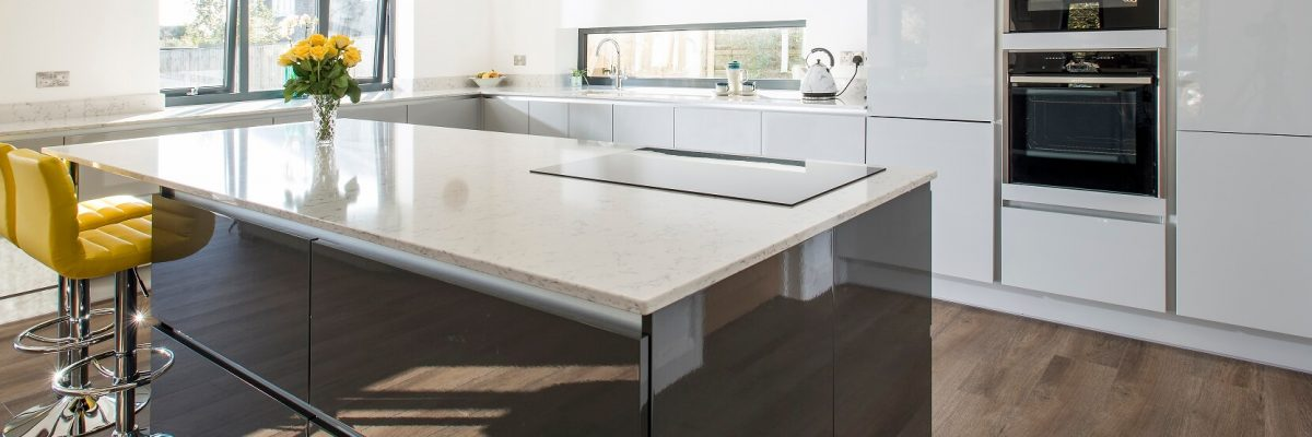 Rotpunkt Linear kitchen in gloss finish with two tone cabinets in white and grey colour scheme
