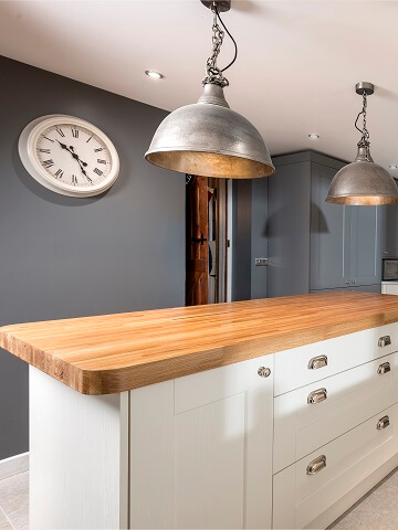 Casa Ashbourne kitchen with navy feature wall and island.