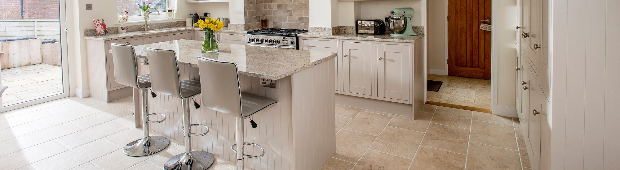 Sheraton Lissa Oak painted kitchen in taupe finish. Complete with granite worktops and upstands
