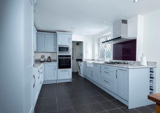 Casa Ashbourne kitchen in white colour scheme with double Belfast sink.
