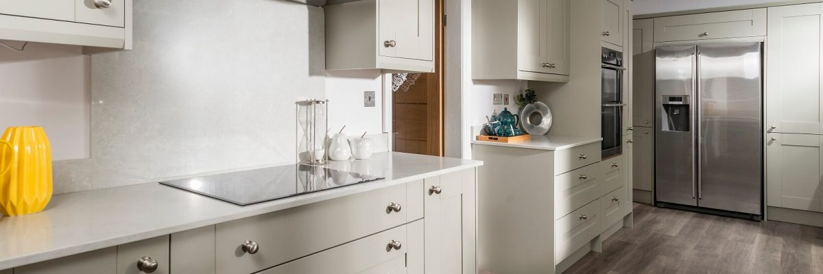 Casa Ashbourne kitchen in neutral colour scheme with stainless steel appliances and handles.
