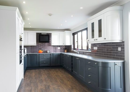 Casa Ashbourne kitchen in grey and white colour scheme with two kitchen cabinets. Complete with built in appliances and extractor fan.