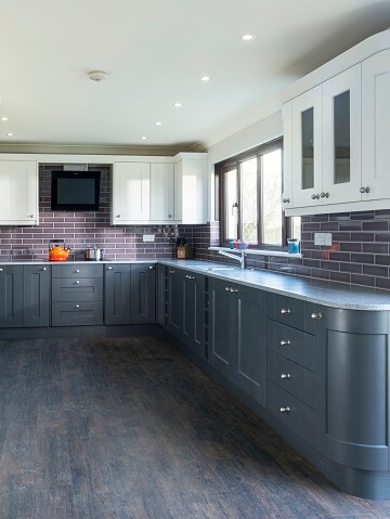 Painted kitchen with two tone cabinets in grey and white colour scheme