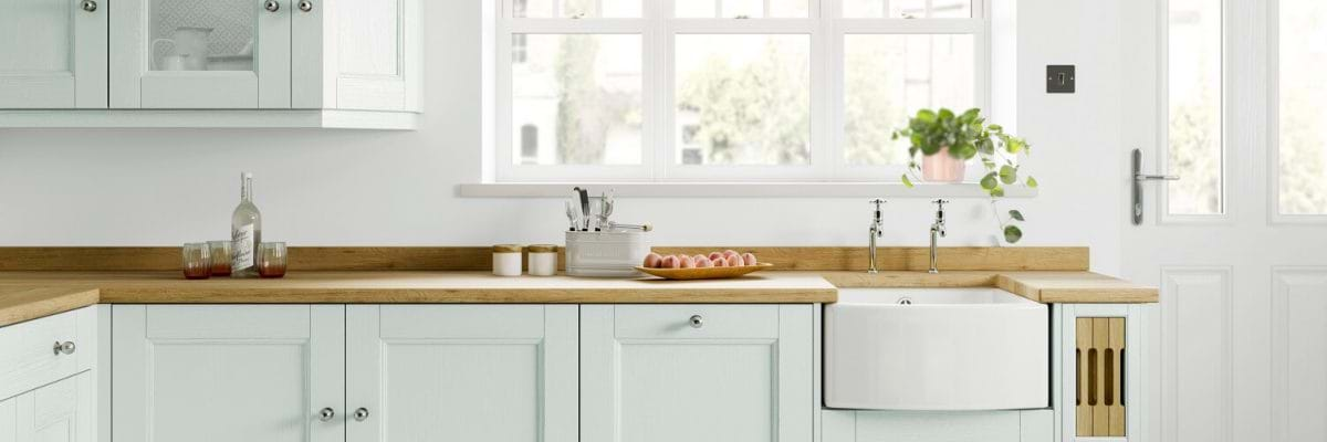 Laura Ashley Rosedale kitchen with two tone painted cabinets and Blefast sink