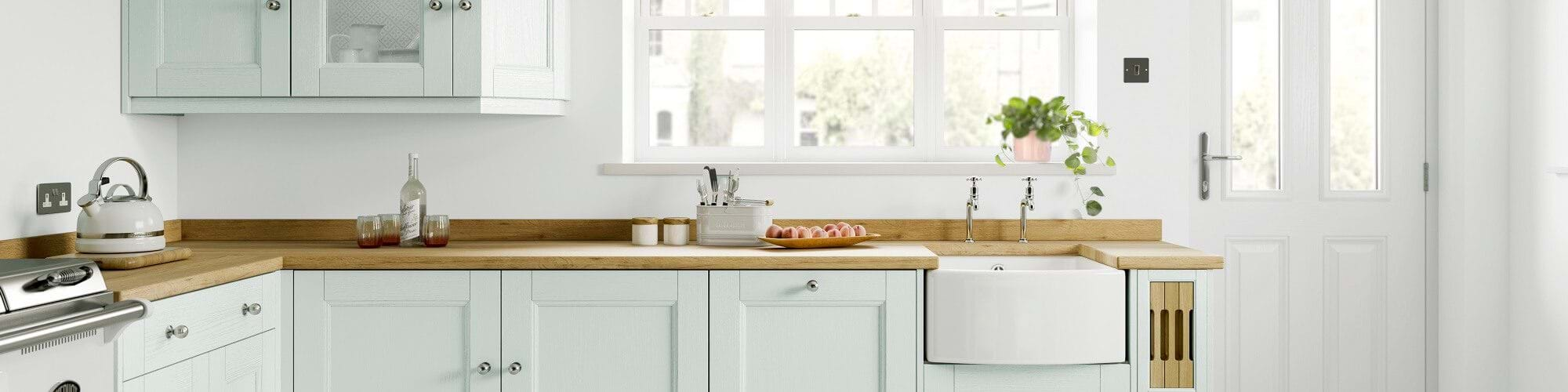 Laura Ashley Rosedale painted wood kitchen in chalk white and pale duck egg
