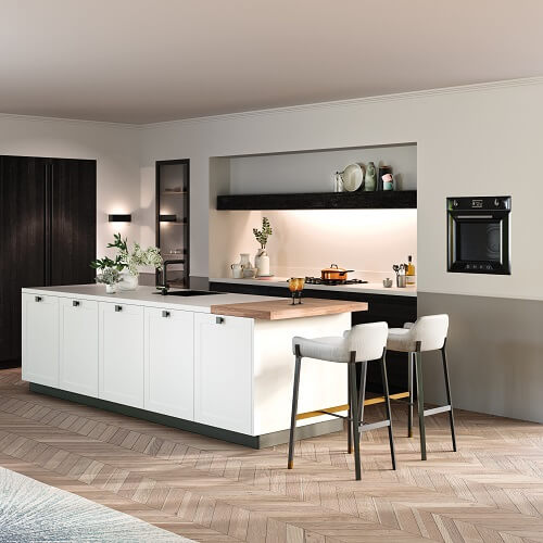 Rot Punkt kitchen with two tone cabinets in black and white colour scheme with island and breakfast bar