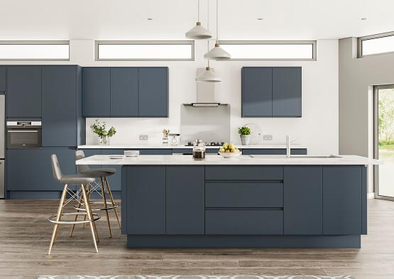 Casa New York contemporary kitchen with matt painted finished in on-trend indigo blue colour scheme