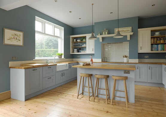 Laura Ashley Whitby shaker kitchen in pale blue colour scheme with wood worktops