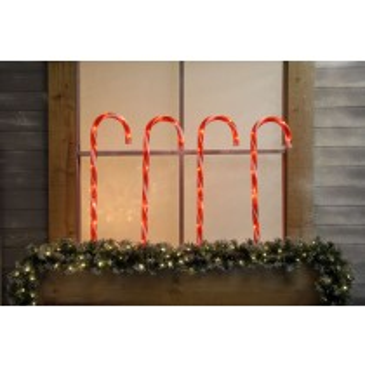 Festive Set Of 4 Lit Candy Cane Stake Lights